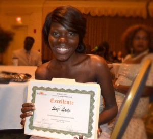Suzi receives excellence award for contribution to the community. Erie 2014.